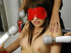 Blindfolded and restrained Asian cock sucker endures a group toying